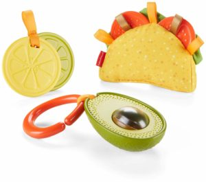Three fisher-price taco pieces