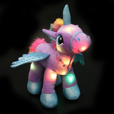 This is an image of a purple unicorn plush night light.