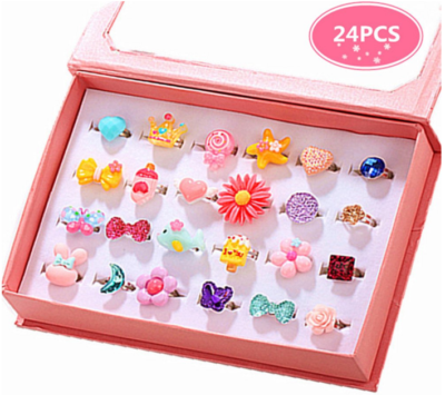 This is an image of kid's jewel rings in box, colorful colors