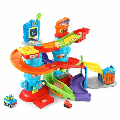 This is an image of a smart wheels police tower toy for toddlers by VTech.