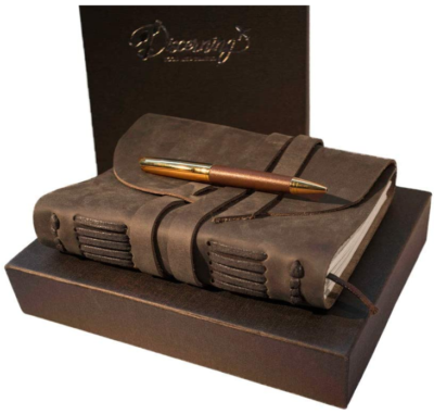 This is an image of girl's leather journet gift set in brown color