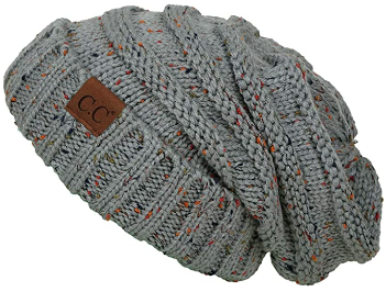 This is an image of girl's cable knit beanie in gray color