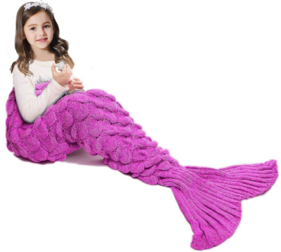 This is an image of girl's blanket with mermaid tail design in pink color