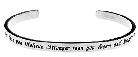 This is an image of girl's jewelry with a quote in black and silver colors