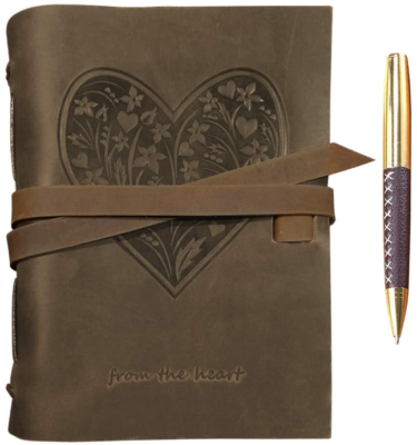 This is an image of girl's leather journal with a heart flowers graphic in brown color