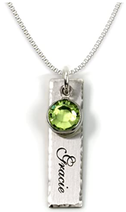 This is an image of girl's personalized charm necklace in silver and green colors
