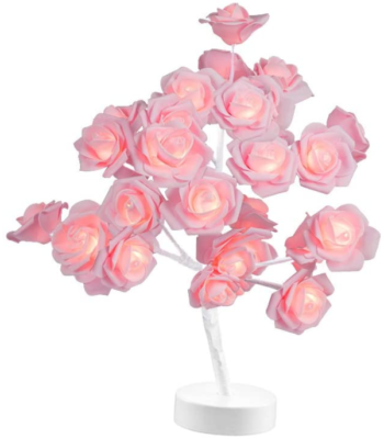 This is an image of girl's rose lamp for desk or table in white and pink colors